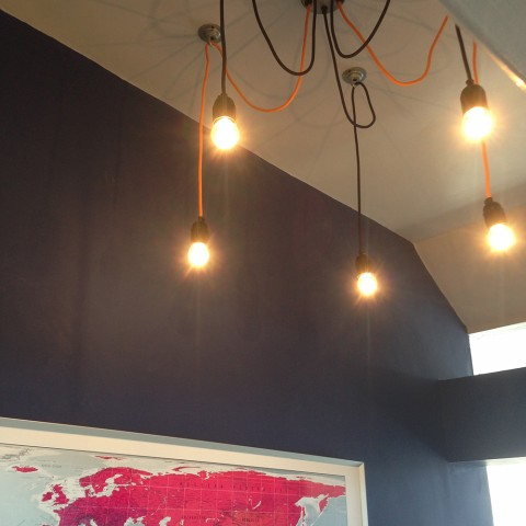 chandelier and map wall